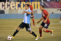 Javier Mascherano (14) of Argentina is trailed by Landon Donovan (10) of the United States. The United States (USA) and Argentina (ARG) played to a 1-1 tie during an international friendly at the New Meadowlands Stadium in East Rutherford, NJ, on March 26, 2011.