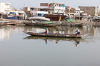 Senegal, Saint Louis.  Canoe Ferrying Passengers Across the Senegal River from Guet N'Dar to Saint Louis.
