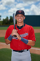 GCL Twins Keoni Cavaco (9) poses for a photo after a Gulf Coast League game against the GCL Pirates on August 6, 2019 at Pirate City in Bradenton, Florida.  GCL Twins defeated the GCL Pirates 1-0 in the second game of a doubleheader.  (Mike Janes/Four Seam Images)