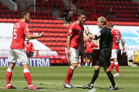 Tom Lockyer and Jason Pearce of Charlton argue with referee, Gavin Ward, after a decision during Charlton Athletic vs Wigan Athletic, Sky Bet EFL Championship Football at The Valley on 18th July 2020
