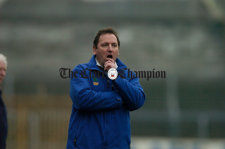 Clare manager Michael Brennan watches carefully the performance of his charges during their NFL match against Carlow in Cusack Park. Photograph by John Kelly.