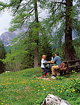 Italy, South Tyrol, Alto Adige, Dolomites, couple having a break from hiking