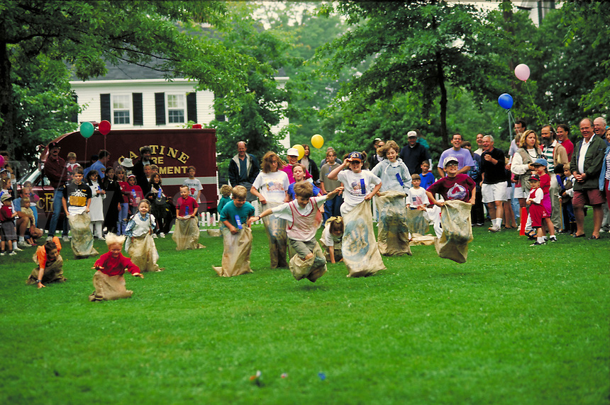 children in 4th of July celebrational sack race. Castine Maine United States small town in coastal Maine.