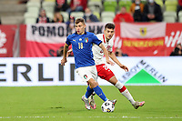 11th October 2020, The Stadion Energa Gdansk, Gdansk, Poland; UEFA Nations League football, Poland versus Italy; NICOLA BARELLA holds off the challenge from JAKUB MODER