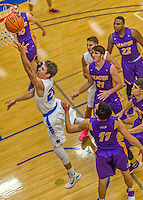 22 November 2015: Yeshiva University Maccabee Guard Shaje Weiss, a Senior from Edison, NJ, lays one up in the second half of play against the Hunter College Hawks at the Max Stern Athletic Center  in New York, NY. The Maccabees defeated the Hawks 81-71 in non-conference play, for their second win of the season. Mandatory Credit: Ed Wolfstein Photo *** RAW (NEF) Image File Available ***