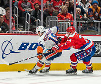 WASHINGTON, DC - JANUARY 31: Jonas Siegenthaler $34 of the Washington Capitals checks into Anthony Beauvillier #18 of the New York Islanders during a game between New York Islanders and Washington Capitals at Capital One Arena on January 31, 2020 in Washington, DC.