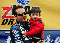 Sept. 18, 2011; Concord, NC, USA: NHRA funny car driver Tony Pedregon with his son during the O'Reilly Auto Parts Nationals at zMax Dragway. Mandatory Credit: Mark J. Rebilas-