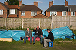Three spectators enjoying a pre-match drink at Yockings Park before Whitchurch Alport hosted Cammell Laird 1907 in the 2017-18 North West Counties Division One play-off final. Alport were formed in 1946 and were named after Alport Farm, Whitchurch, which had been the home of a local footballer Coley Maddocks who had been killed in action in the war. The home team won the match 2-1 watched by a crowd of 733, a club record attendance.
