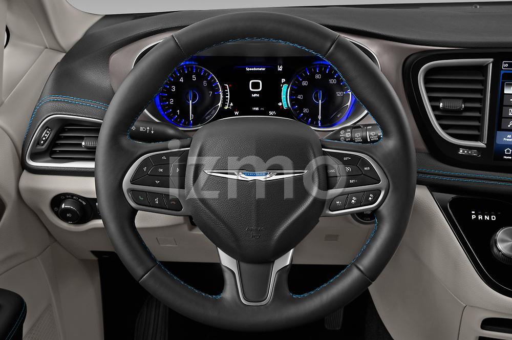 Steering wheel view of a 2021 Chrysler Pacifica Touring-L 5 Door Mini Van
