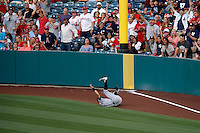 Ichiro Suzuki #31 of the New York Yankees falls to the ground after catching a fly ball during a game against the Los Angeles Angels at Angel Stadium on June 15, 2013 in Anaheim, California. (Larry Goren/Four Seam Images)