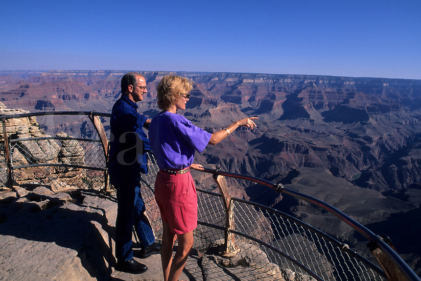 Tourist couple on South Rim of Grand Canyon beautiful image in Arizona US
