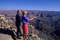 Tourist couple on South Rim of Grand Canyon beautiful image in Arizona US