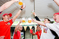(L-R) Michael Klus, David Puda, Kamil, Kamil, and Tomas Hudecek lift their beers to a Czech Republic goal against the United States at the Bohemian Hall and Beer Garden in New York City on June 12, 2006.<br /> <br /> The World Cup, held every four years in different locales, is the world's pre-eminent sports tournament in the world's most popular sport, soccer (or football, as most of the world calls it).  Qualification for the World Cup is open to any country with a national team accredited by FIFA, world soccer's governing body. The first World Cup, organized by FIFA in response to the popularity of the first Olympic Games' soccer tournaments, was held in 1930 in Uruguay and was participated in by 13 nations.    <br /> <br /> As of 2010 there are 208 such teams.  The final field of the World Cup is narrowed down to 32 national teams in the three years preceding the tournament, with each region of the world allotted a specific number of spots.  <br /> <br /> The World Cup is the most widely regularly watched event in the world, with soccer teams being a source of national pride.  In most nations, the whole country is at a standstill when their team is playing in the tournament, everyone's eyes glued to their televisions or their ears to the radio, to see if their team will prevail.  While the United States in general is a conspicuous exception to the grip of World Cup fever there is one city that is a rather large exception to that rule.  In New York City, the most diverse city in a nation of immigrants, the melting pot that is America is on full display as fans of all nations gather in all possible venues to watch their teams and celebrate where they have come from.