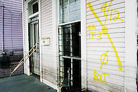 Markings made by search and rescue squads mark most of the houses in New Orleans by September 17, 2005.