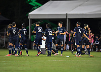 LAKE BUENA VISTA, FL - JULY 26: Sporting KC players cheer after a shootout save by their goalkeeper during a game between Vancouver Whitecaps and Sporting Kansas City at ESPN Wide World of Sports on July 26, 2020 in Lake Buena Vista, Florida.