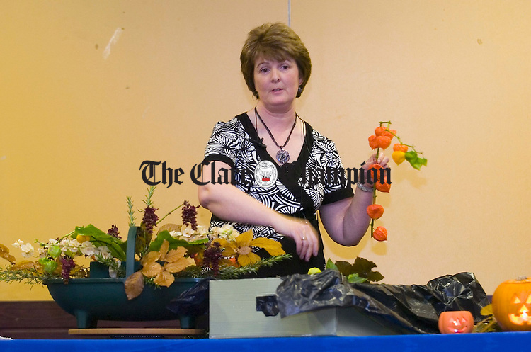 Mary Mc Kee performs a demonstration in the art of arrangements at the Ennis Flower and Garden Club Halloween themed night in the West County Hotel. Photograph by John Kelly.