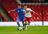 Kalvin Phillips (Leeds United) of England fends off Thomas Delaney (Borussia Dortmund) of Denmark during the UEFA Nations League match played behind closed doors due to the current government Covid-19 rules within sports venues between England and Denmark at Wembley Stadium, London, England on 14 October 2020. Photo by Andy Rowland.