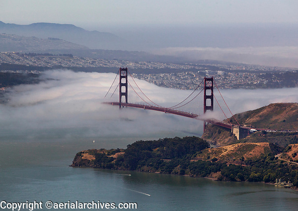 aerial photograph of the Golden Gate bridge with fog San Francisco, California