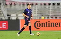 FORT LAUDERDALE, FL - DECEMBER 09: Aaron Long #3 of the United States looks for an open man during a game between El Salvador and USMNT at Inter Miami CF Stadium on December 09, 2020 in Fort Lauderdale, Florida.