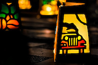 A colorful paper lantern, depicting a Willys Jeep, a symbol of the Colombia coffee region, illuminates the street during the annual Festival of Candles and Lanterns in Quimbaya, Colombia, 8 December 2013. A vibrant event, celebrated since 1982 and attracting tens of thousands of visitors every year, is held in honor of the Virgin Mary, on the day of the Catholic Feast of the Immaculate Conception. Each street and neighborhood in the town compete in the contest to create the most spectacular lighting arrangement of their place, employing creatively elaborated lantern designs, which range from religious themes, to symbols of the coffee region or the environmental and wild nature motives. All the streets in Quimbaya center close for one night and some 40,000 lanterns are being lightened up at the festive night.