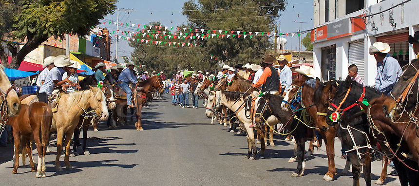 CABALLEROS or Mexican cowboys ride into town to celebrate the festival of the VIRGIN OF GUADALUPE - LOS RODRIGUEZ, GUANAJUATO, MEXICO