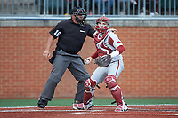 Arkansas Razorbacks catcher Grant Koch (33) checks the runner at first base as home plate umpire Brent Cardwell makes a strike call during the game against the Charlotte 49ers at Hayes Stadium on March 21, 2018 in Charlotte, North Carolina.  The 49ers defeated the Razorbacks 6-3.  (Brian Westerholt/Four Seam Images)