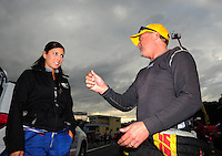 Sept. 30, 2011; Mohnton, PA, USA: NHRA funny car driver Leah Pruett (left) talks with Jeff Arend during qualifying for the Auto Plus Nationals at Maple Grove Raceway. Mandatory Credit: Mark J. Rebilas-