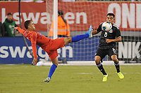 EAST RUTHERFORD, NJ - SEPTEMBER 7: Sergino Dest #18 of the United States battles for the ball with Carlos Rodriguez #8 of Mexico during a game between Mexico and USMNT at MetLife Stadium on September 6, 2019 in East Rutherford, New Jersey.