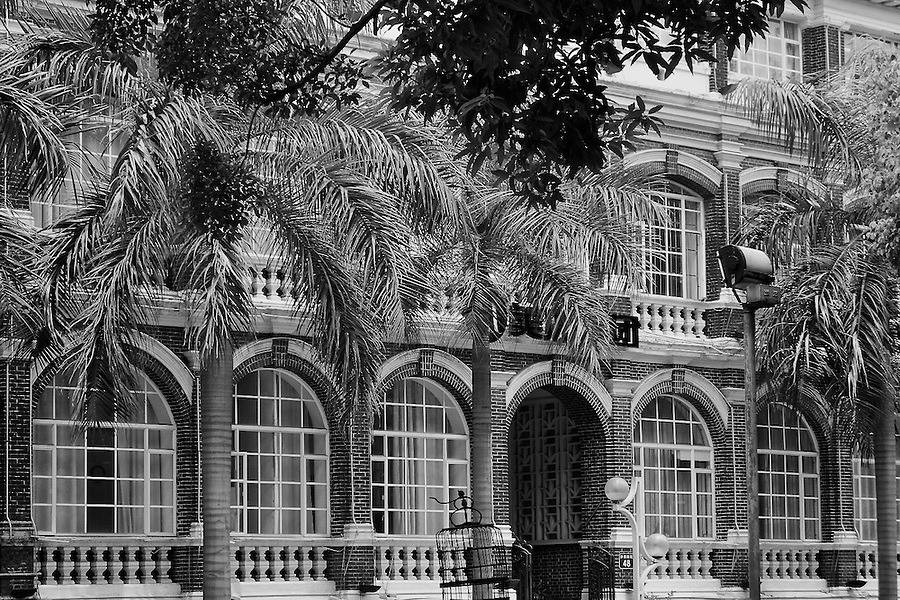 The office building on Shamian (Shameen) Island in monochrome, and before a restoration in 2010.