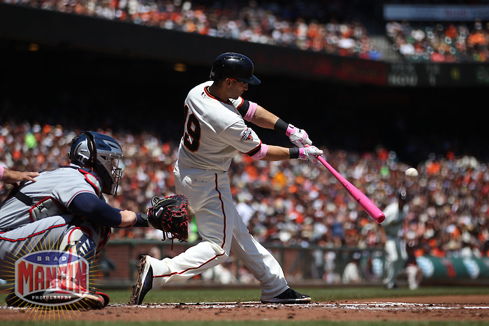 SAN FRANCISCO, CA - MAY 12:  Marco Scutaro #19 of the San Francisco Giants bats using a pink bat in honor of Mother's Day and breast cancer awareness against the Atlanta Braves during the game at AT&T Park on Sunday, May 12, 2013 in San Francisco, California. Photo by Brad Mangin