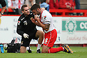 Physio Paul Dando treats Jon Ashton of Stevenage<br />  - Stevenage v Leyton Orient - Sky Bet League 1 - Lamex Stadium, Stevenage - 17th August, 2013<br />  © Kevin Coleman 2013