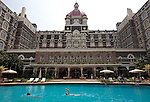 MUMBAI, INDIA - SEPTEMBER 27, 2010: Swimmers do laps of the pool at The Taj Mahal Palace and Tower Hotel in Mumbai. The Hotel has re-opened after the terror attacks of 2008 destroyed much of the heritage wing. The wing has been renovated and the hotel is once again the shining jewel of Mumbai. pic Graham Crouch