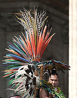 Un uomo con indosso il costume tradizionale dell'Amazonia durante l'udienza generale del mercoledi' in Piazza San Pietro, Citta' del Vaticano, 30 maggio, 2018.<br /> A man wearing a traditional feathered costume from the Amazon attends Pope Francis' weekly general audience in St. Peter's Square, at the Vatican, on May 30, 2018.<br /> UPDATE IMAGES PRESS/IsabellaBonotto<br /> <br /> STRICTLY ONLY FOR EDITORIAL USE