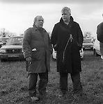 Hare Coursing.Greyhound 2000 Meet. Near Six Mile Bottom, Newmarket, Suffolk. Two working class men, the pencil on a piece of string tied to a button of his coat is so he does loose it. Pencil is used to mark his race card.