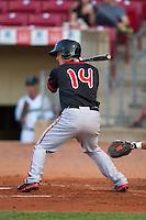 Lansing Lugnuts second baseman Christian Lopes #14 bats during a game against the Cedar Rapids Kernels at Veterans Memorial Stadium on April 29, 2013 in Cedar Rapids, Iowa. (Brace Hemmelgarn/Four Seam Images)