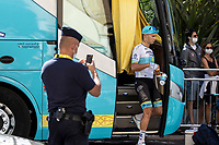 French Police officer taking a snapshot of Alexey Lutsenko (UKR/Astana) pre race<br /> <br /> 107th Tour de France 2020 (2.UWT)<br /> (the 'postponed edition' held in september)<br /> Stage 2 from Nice to Nice 186km<br /> ©kramon