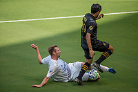 LOS ANGELES, CA - AUGUST 22: Nicholas DePuy #20 of the Los Angeles Galaxy slide tackles Carlos Vela #10 of LAFC during a game between Los Angeles Galaxy and Los Angeles FC at Banc of California Stadium on August 22, 2020 in Los Angeles, California.