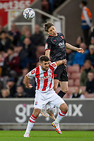 1st October 2021;  Bet365 Stadium, Stoke, Staffordshire, England; EFL Championship football, Stoke City versus West Bromwich Albion; Adam Reach of West Bromwich Albion heads the ball