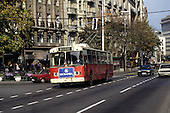 Belgrade, Serbia, Yugoslavia. Busy street - bus, cars; buildings in the background.