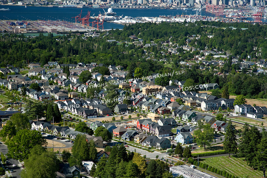 High Point, West Seattle, WA; An aerial view of High Point, a mixed housing development in West Seattle, with downtown Seattle and the Port of Seattle in the background.