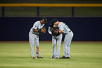 Surprise Saguaros outfielders Bubba Thompson (21), Kyle Isbel (12), and Brewer Hicklen (23) celebrate a victory after an Arizona Fall League game against the Peoria Javelinas on September 22, 2019 at Peoria Sports Complex in Peoria, Arizona. Surprise defeated Peoria 2-1. (Zachary Lucy/Four Seam Images)
