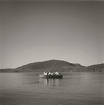 Scan of vintage print. Small boat with six people. Moosehead Lake, ME. 1995; negative file #95-0212 R#4; 1 of 1