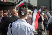 """Ueber 1.000 Rechtsextreme aus mehreren Bundeslaendern demonstrieren am Samstag den 19. August 2017 in Berlin zum Gedenken an den Hitler-Stellvertreter Rudolf Hess.<br /> Rudolf Hess hatte am 17. August 1987 im Alliierten Kriegsverbrechergefaengnis in Berlin Spandau Selbstmord begangen. Seitdem marschieren Rechtsextremisten am Wochenende nach dem Todestag mit sog. """"Hess-Maerschen"""".<br /> Weit ueber 1.000 Menschen protestierten gegen den Aufmarsch der Rechtsextremisten und stoppten den Hess-Marsch nach 300 Metern u.a. mit Sitzblockaden. Der rechtsextreme Aufmarsch wurde daraufhin von der Polizei umgeleitet.<br /> Aus dem Aufmarsch wurden mehrfach Gegendemonstranten angegriffen, mindestens ein Neonazi wurde festgenommen.<br /> Im Bild: Ein Rechtsextremer mit """"NS"""" (Nationalsozialismus) und einem Totenkopf auf der Kappe.<br /> 19.8.2017, Berlin<br /> Copyright: Christian-Ditsch.de<br /> [Inhaltsveraendernde Manipulation des Fotos nur nach ausdruecklicher Genehmigung des Fotografen. Vereinbarungen ueber Abtretung von Persoenlichkeitsrechten/Model Release der abgebildeten Person/Personen liegen nicht vor. NO MODEL RELEASE! Nur fuer Redaktionelle Zwecke. Don't publish without copyright Christian-Ditsch.de, Veroeffentlichung nur mit Fotografennennung, sowie gegen Honorar, MwSt. und Beleg. Konto: I N G - D i B a, IBAN DE58500105175400192269, BIC INGDDEFFXXX, Kontakt: post@christian-ditsch.de<br /> Bei der Bearbeitung der Dateiinformationen darf die Urheberkennzeichnung in den EXIF- und  IPTC-Daten nicht entfernt werden, diese sind in digitalen Medien nach §95c UrhG rechtlich geschuetzt. Der Urhebervermerk wird gemaess §13 UrhG verlangt.]"""