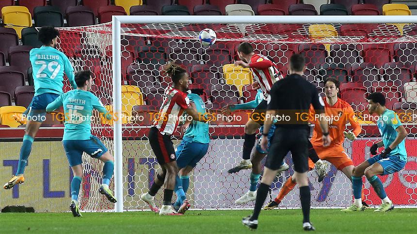 Henrik Dalsgaard scores Brentford's opening goal with a fine header during Brentford vs AFC Bournemouth, Sky Bet EFL Championship Football at the Brentford Community Stadium on 30th December 2020