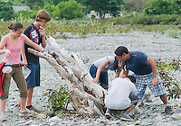 American students Caitlin Sanchez, Jester Ceballos, Marianna Tucci, and Eric Leatham are joined by Timorese Benny Carvalho in a search for lizards in a riverbed in the Liquica district of Timor-Leste (East Timor). They are participating in an ongoing survey of Timorese reptiles and amphibians.