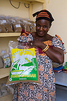 Village Cooperative Member Displays Bag of Couscous made from Local Millet, near Kaolack, Senegal. DOZENS MORE OF IMAGES RELATED TO MILLET CULTIVATION ARE AVAILABLE.  WHAT DO YOU NEED?