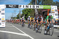 Joe Cooper (yellow jersey) stays near the front of the peleton during stage five of the NZ Cycle Classic UCI Oceania Tour in Masterton, New Zealand on Tuesday, 26 January 2017. Photo: Dave Lintott / lintottphoto.co.nz