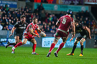 Friday 03 January 2014<br /> Pictured:Gareth Davies of the Scarlets passes the ball out <br /> Re: Ospreys v Scarlets, Rabo Direct Pro 12 match at the Liberty Stadium Swansea, Wales