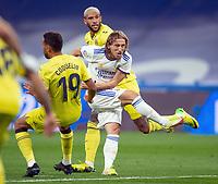 25th September 2021; Estadio Santiagp Bernabeu, Madrid, Spain; Men's La Liga, Real Madrid CF versus Villarreal CF; Luka Modric shoots on goal under  pressure from Capoue and Coquelin of Villarreal