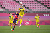 KASHIMA, JAPAN - AUGUST 5: Alanna Kennedy #14 of Australia goes up for a header during a game between Australia and USWNT at Kashima Soccer Stadium on August 5, 2021 in Kashima, Japan.